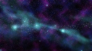 A nebula of greens and purples in space