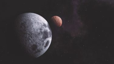 An illustration showing a planet and moon