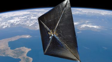 A solar sail deployed in orbit of the Earth