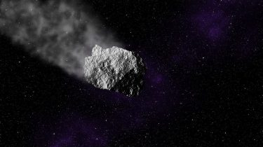 An asteroid traveling through space and ablating some material